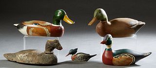 "Four Duck Decoys, 20th c., one Dogris marked Hogarth; 2 blue winged teal; and a widgeon; together with a diminutive carved ""First Merganser,"" 1975, by"