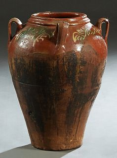 French Provincial Partially Glazed Clay Oil Jar, late 19th c., with four ring handles, the shoulders with polychromed decoration, H.- 22 in., Dia.- 16
