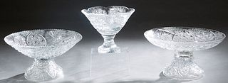 Group of Three Pieces of Cut Glass, 20th/21st c., consisting of two scalloped circular bowls on circular bases, and a taller scalloped top bowl on a s