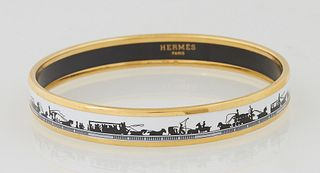 """Hermes Narrow White Enamel Bracelet, with horse and carriage decoration, marked """"Hermes Paris,"""" H.- 3/8 in., Dia.- 2 1/2 in. Provenance: The Estate of"""