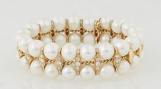 Vintage Lady's 18K Yellow Gold Pearl Double Bangle Bracelet, with a central gold twisted wire with marquise gold separators, the seven separators in t