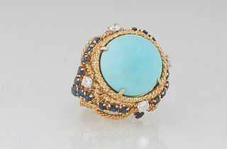 Lady's 18K Yellow Gold Dinner Ring, with a cabochon circular app 8 carat Persian turquoise, atop a twisted gold border over pierced swirling sides mou