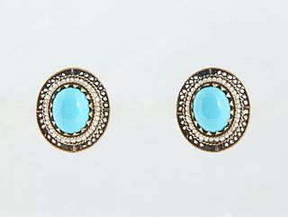 Vintage Pair of 18K Yellow Gold Pierced Earrings, with an oval app 2.5 ct. cabochon Persian turquoise atop a graduated border of tiny seed pearls and