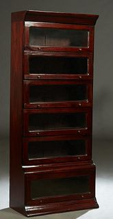 Carved Mahogany Barrister Style Bookcase, 20th c., the ogee crown over six shelves with lifting glazed doors, H.- 75 in., W.- 31 3/4 in., D.- 16 in.