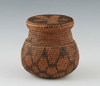 Southwestern Native American Basket, late 19th/early 20th c., possibly Apache, the tri-color covered storage jar with fitted lid and star motif, the b