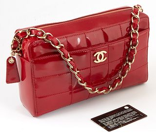 Chanel Red Chocobar Patent Leather Logo Zip Shoulder Bag, c.2002-2003, the chain interlaced with red patent leather, with a front pocket and golden br