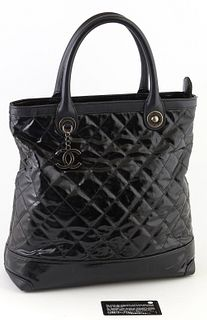 Chanel Black Patented Quilted Leather Logo Charm Tall Tote Handbag, the brushed silver hardware and logo charm, opening to a burgundy interior with ke