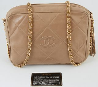 Chanel Beige Large Quilted Calf Leather Camera Tussle Bag, c. 1986-1988, the gold chain interlaced with beige leather, the exterior with beige stitchi