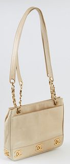 Vintage Chanel Triple Logo Chain Beige Calf Leather Shoulder Bag, c. 2019, with gold hardware, the exterior of the bag with two open pockets on either