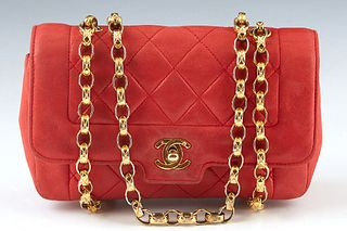 Chanel Red Leather Quilted Purse, with gold hardware, the interior of the bag lined in matching red leather with an open side compartment and a zip cl