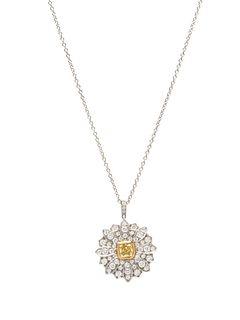 TIFFANY & CO., YELLOW DIAMOND AND DIAMOND 'DAISY' PENDANT/NECKLACE