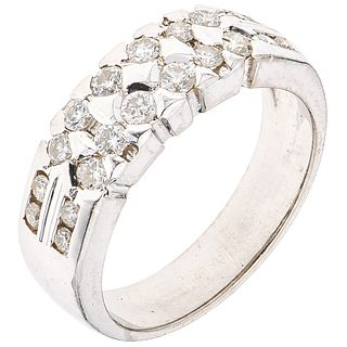 RING WITH DIAMONDS IN 18K WHITE GOLD 20 Brilliant cut diamonds ~0.60 ct. Weight: 6.7 g. Size: 7