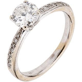 RING WITH DIAMONDS IN 14K WHITE GOLD 1 Brilliant cut diamond~0.70ct Clarity: I2-I3, 14 Brilliant cut diamonds~0.14ct