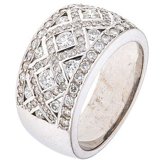 RING WITH DIAMONDS IN 18K WHITE GOLD 81 Brilliant cut diamonds ~1.10 ct. Weight: 11.7 g. Size: 7 ½