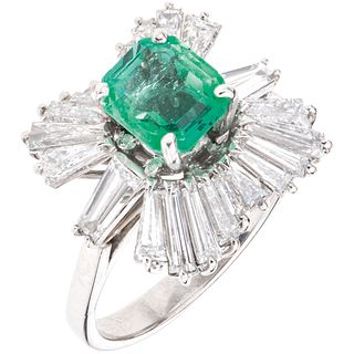 RING WITH EMERALD AND DIAMONDS IN 14K WHITE GOLD 1 Octagonal cut emerald ~1.0 ct and 22 Baguette cut diamonds~2.40 ct