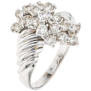 RING WITH DIAMONDS IN 14K WHITE GOLD 17 Brilliant cut diamonds ~1.0 ct  Weight: 5.5 g. Size: 9