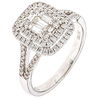RING WITH DIAMONDS IN 18K WHITE GOLD 5 Baguette cut diamonds ~0.30 ct and 84 Brilliant cut diamonds ~0.50 ct. Size: 7 ½