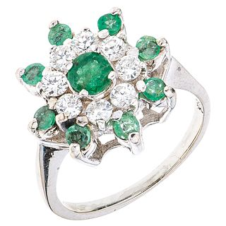 RING WITH EMERALDS AND DIAMONDS IN 14K WHITE GOLD 9 Round cut emeralds ~0.60 ct and 8 Brilliant cut diamonds~0.56 ct
