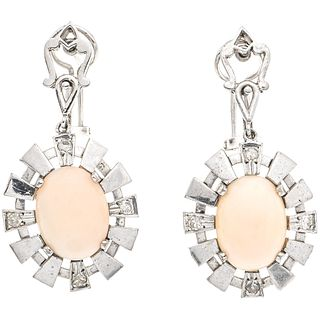 PAIR OF EARRINGS WITH CORALS AND DIAMONDS IN PALLADIUM SILVER 2 Pink corals ~8.0 ct, 8 8x8 cut diamonds ~0.24 ct. Weight: 11.8 g
