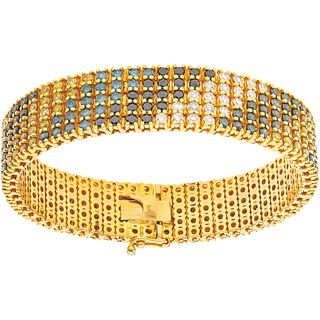 BRACELET WITH DIAMONDS IN 10K YELLOW GOLD 295 yellow, blue/green, black, white diamonds ~17.7 ct. Weight: 86.3 g