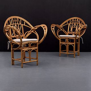 Pair of McGuire Rattan Arm Chairs, Paige Rense Noland Estate