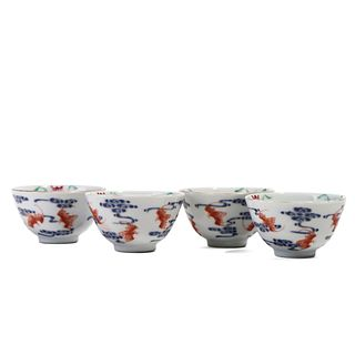 FOUR BLUE AND WHITE AND COPPER RED CUPS
