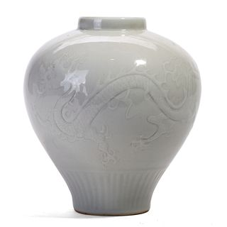 A CHINESE WHITE CARVED FLORAL JAR