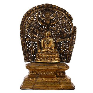 A TIBETAN GILT-BRONZE FIGURE OF SHAKYAMUNI
