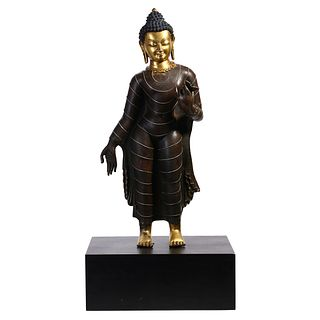 A TIBETAN PARTIALLY GILT-BRONZE FIGURE OF SHAKYAMUNI