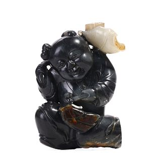 A BLACK AND WHITE JADE BOY CARVING