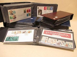 Seven albums of 1970s and later first day covers, unused commemorative packs, few Machins, etc
