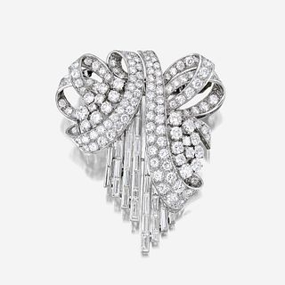 A diamond and platinum clip/brooch