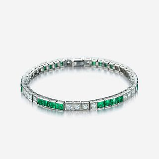 An eighteen karat white gold, diamond, and emerald line bracelet