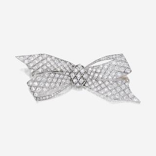 A diamond and platinum brooch