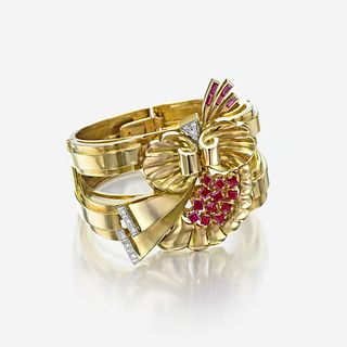 A Retro eighteen karat gold, ruby, and diamond bangle bracelet