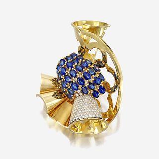 A Retro eighteen karat gold, sapphire, and diamond brooch