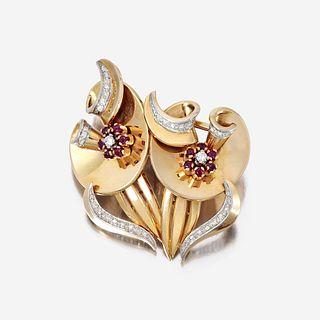 A Retro eighteen karat gold, diamond, and ruby clip/brooch