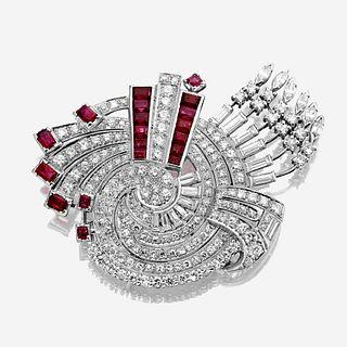 A diamond, ruby, and platinum brooch