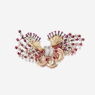 A Retro fourteen karat bicolor gold, diamond, and ruby clip/brooch