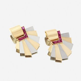 A pair of Retro eighteen karat bicolor gold and ruby ear clips