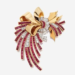 An eighteen karat gold, ruby, and diamond brooch