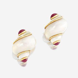 A pair of turbo shell, ruby, and eighteen karat gold ear clips, Seaman Schepps