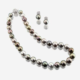 A South Sea Tahitian cultured pearl, diamond, and eighteen karat white gold necklace with similar earclips