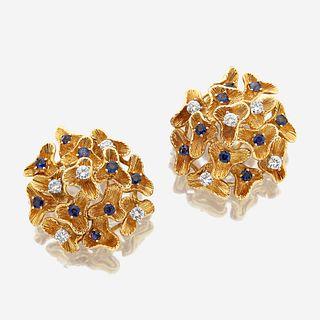 A pair of eighteen karat gold, sapphire, and diamond ear clips