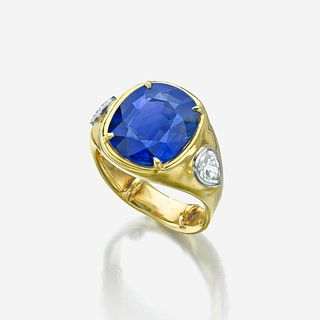A sapphire, diamond, and eighteen karat gold ring