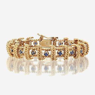 A fourteen karat gold and sapphire bracelet