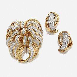 An eighteen karat gold and diamond brooch and matching earrings