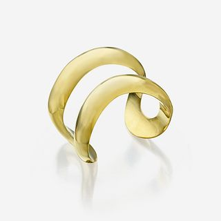 "An eighteen karat gold bracelet, Tiffany & Co. Elsa Peretti, ""Open Center Cuff,"" 1975"