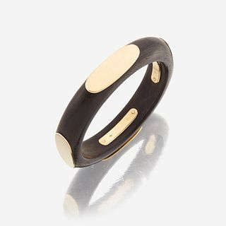 An eighteen karat gold and wooden bangle, Van Cleef & Arpels c. 1970