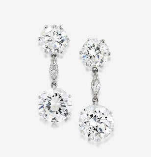 A pair of diamond and eighteen karat white gold earrings